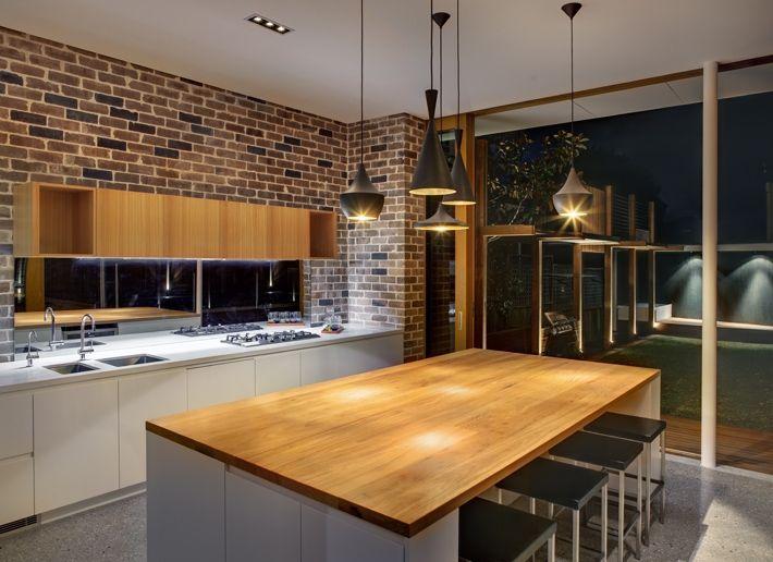 CplusC - Sydney Architects and Builders. Castlecrag kitchen in the evening #sydney #architecture #kitchens