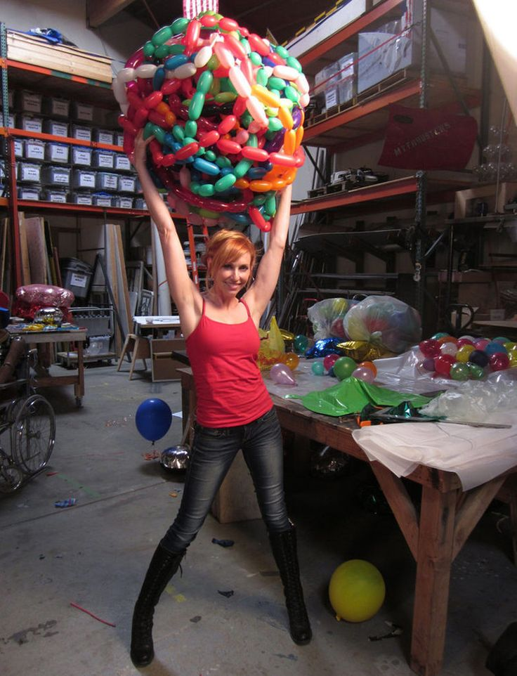 Kari Byron holding up a big ball of balloons