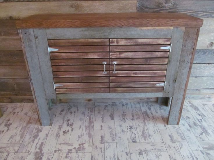 Barn wood upcycle - old fish tank stand upcycled with reclaimed wood and new hardware.  Check out the blog post to see the before and find out how it was done.