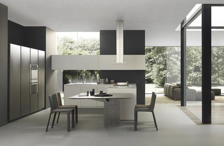 Nata per stupire: rigore geometrico che costruisce la linea creativa di questa cucina moderna.