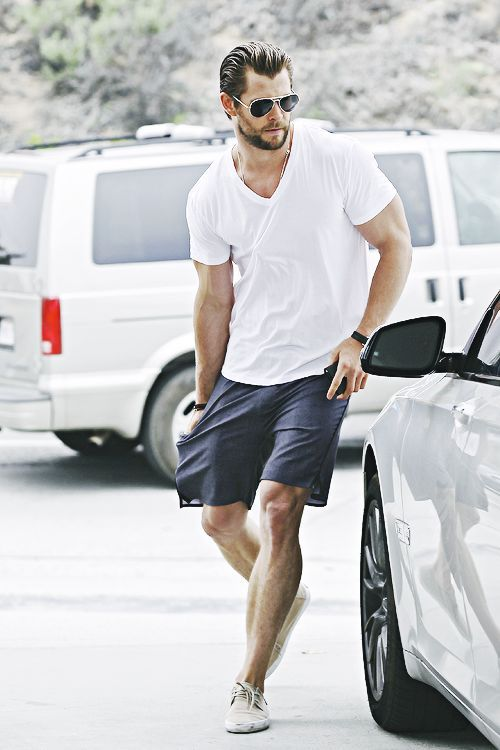Shop this look on Lookastic:  http://lookastic.com/men/looks/sunglasses-v-neck-t-shirt-watch-bracelet-shorts-low-top-sneakers/10656  — Black Sunglasses  — White V-neck T-shirt  — Black Canvas Watch  — Black Woven Bracelet  — Navy Shorts  — Beige Canvas Low Top Sneakers