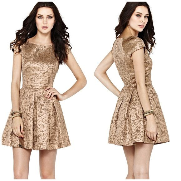 Gorgeous French Connection Gold Brocade Dress So beautiful and perfect for a party! Excellent pre worn, no noticeable flaws! Size 6 and true to size. Flattering pleated detail. No trades!! 05311650gws French Connection Dresses
