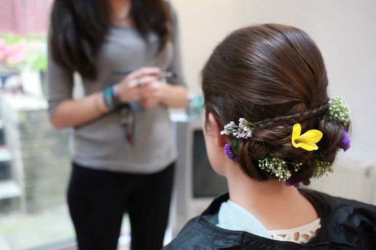 Wedding hair- purple yellow and white flowers, updo with plait. Bride. Photography by Sara callow