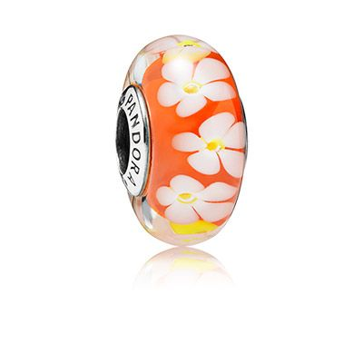Inspired by the exotic frangipani flower, the bright orange colored glass charm features a wreath of sweet flowers with a striking 3D optical effect. #PANDORA #PANDORAcharm