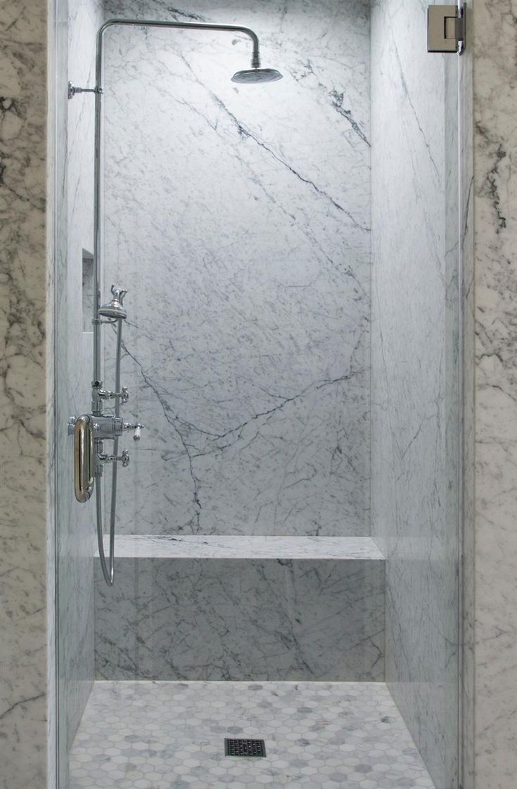 Marble Slab Shower With Simple Bench And Different Floor