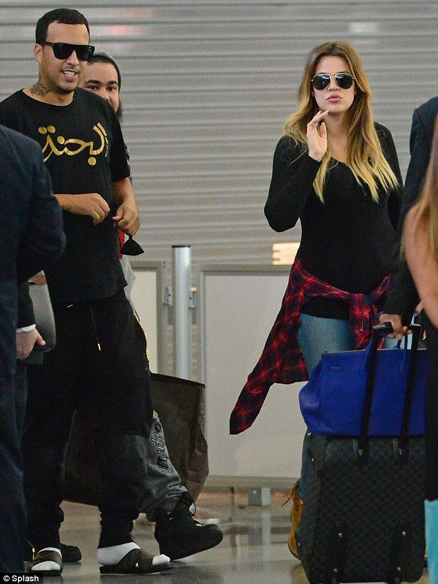Khloe Kardashian and boyfriend French Montana dress down as they arrive in New York City after partying in Las Vegas.