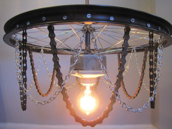 We created this light from the front wheel of an old bike (17 diameter), bike chains, various light fixture and lamp parts, and utility chains.