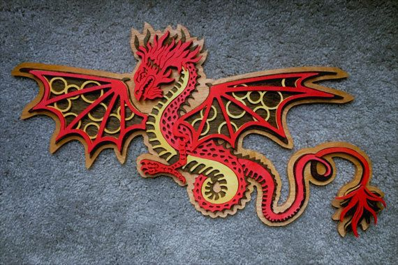 This gorgeous multi-layered dragon will class up any wall. Made by Wood Art by TAM. Get yours today!