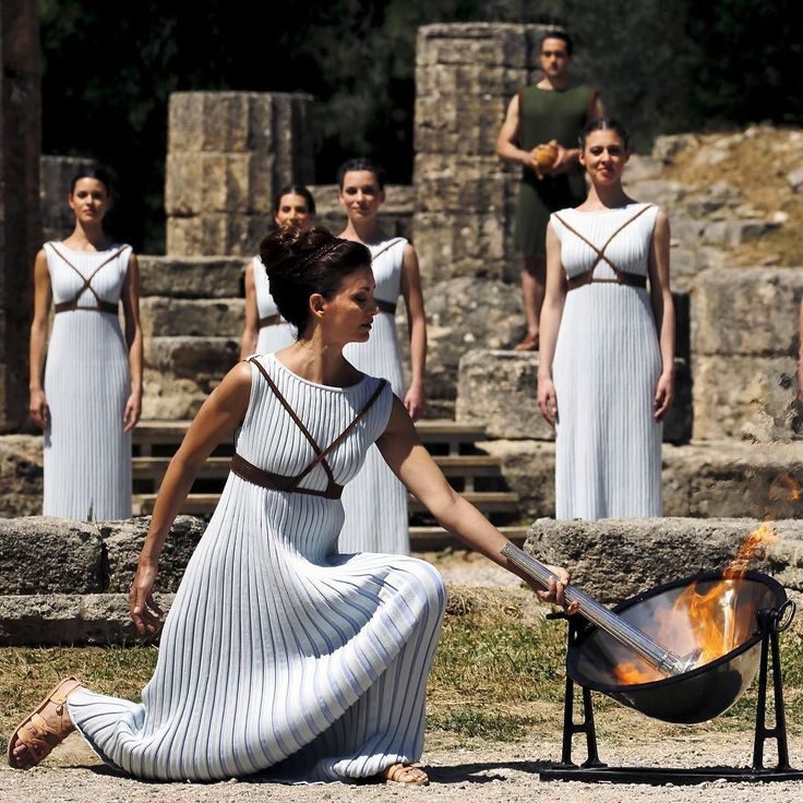Greek actress Katerina Lehou playing the role of High Priestess lights a torch from the sun's rays reflected in a parabolic mirror during the dress rehearsal for the Olympic flame lighting ceremony for the Rio 2016 Olympic Games at the site of ancient Olympia in Greece April 20 2016.  Photograph by Yannis Behrakis@reuters. #Olympics