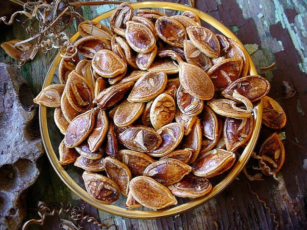 When cooking butternut squash, dont throw out the seeds when you can roast them into these tasty treats.  The warm aroma of cinnamon and vanilla fills our home while these roast.  They are crispy and have just the right balance of flavors.  This recipe calls for butternut squash seeds, but the seeds of any other winter squash could be substituted such as pumpkin, acorn, hubbard, etc.  Do note, however, that larger seeds will take a bit longer to roast.