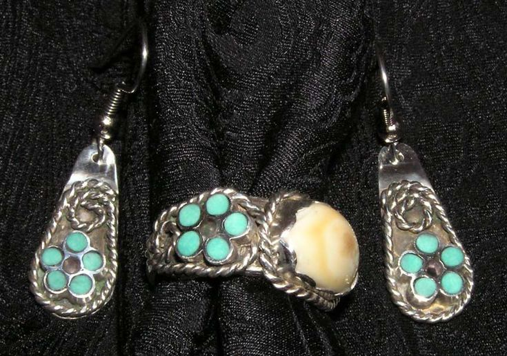Custom jewelry by John P. Finley. Silver ring with elk ivory, turquoise and amethyst, with matching earrings