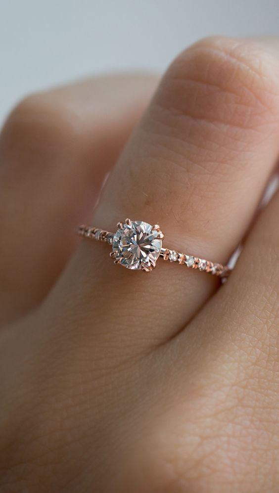 The perfect vintage diamond solitaire. Handset pavé side stones, double claw prongs, and a beautiful reclaimed diamond.