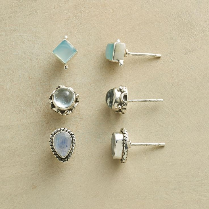 "FANCIFUL FRAMED EARRING TRIO -- Exhibit your good taste in a shining moonstone, aquamarine and chalcedony stud earrings set of sterling silver. Exclusive. Set of 3. 5/16"" to 3/8""L."