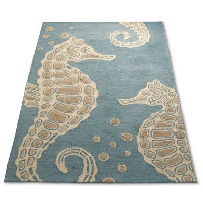 soft teal OUTDOOR rug with beige cream seahorse motif