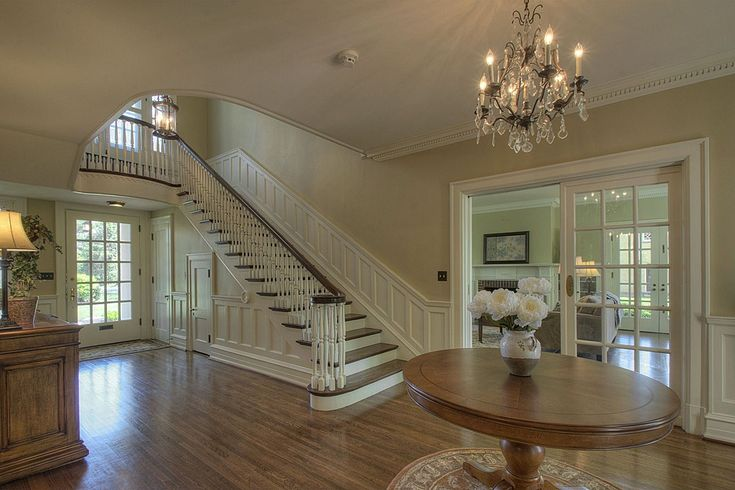 1929 Colonial Revival – Reading, PA - French doors and curved stairs like ours; love the paint color and wainscoting, and that chandelier!