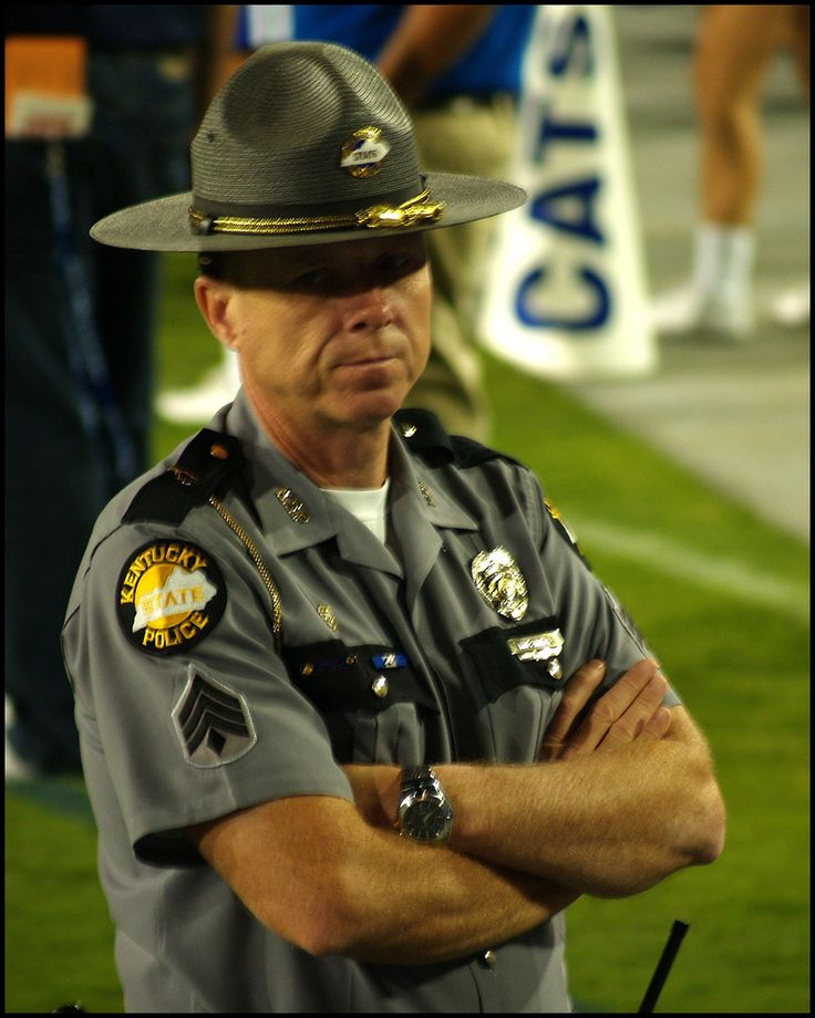 https://flic.kr/p/5jBSqL | no nonsense! | He must have spotted a Yankee in the stands! A Kentucky State Trooper keeps the peace at a University of Kentucky football game.