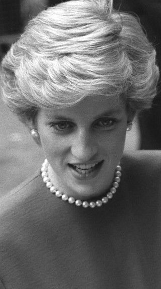 A Beautiful Black and White Photograph of Princess Diana wearing her ubiquitous pearl (chocker) necklace.