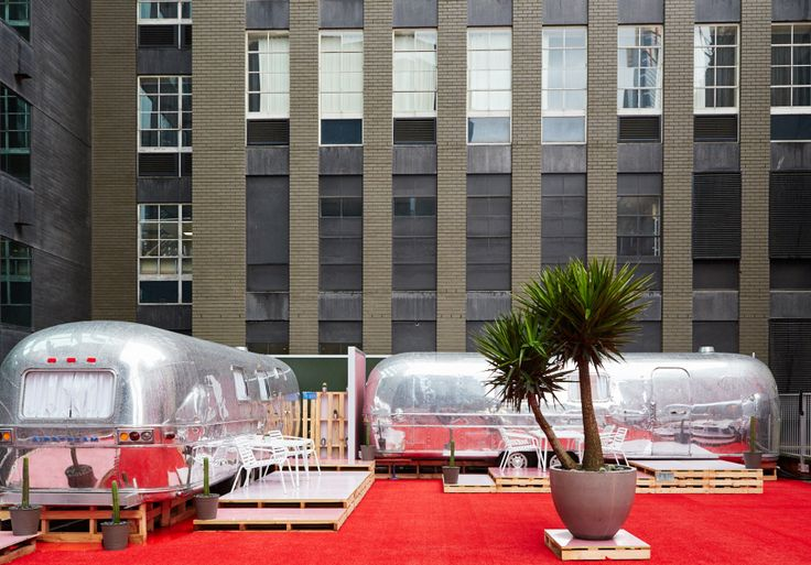 Six Airstream caravans hoisted on a Flinders Lane rooftop. Melbourne's out-Melbourned itself with this new boutique hotel.