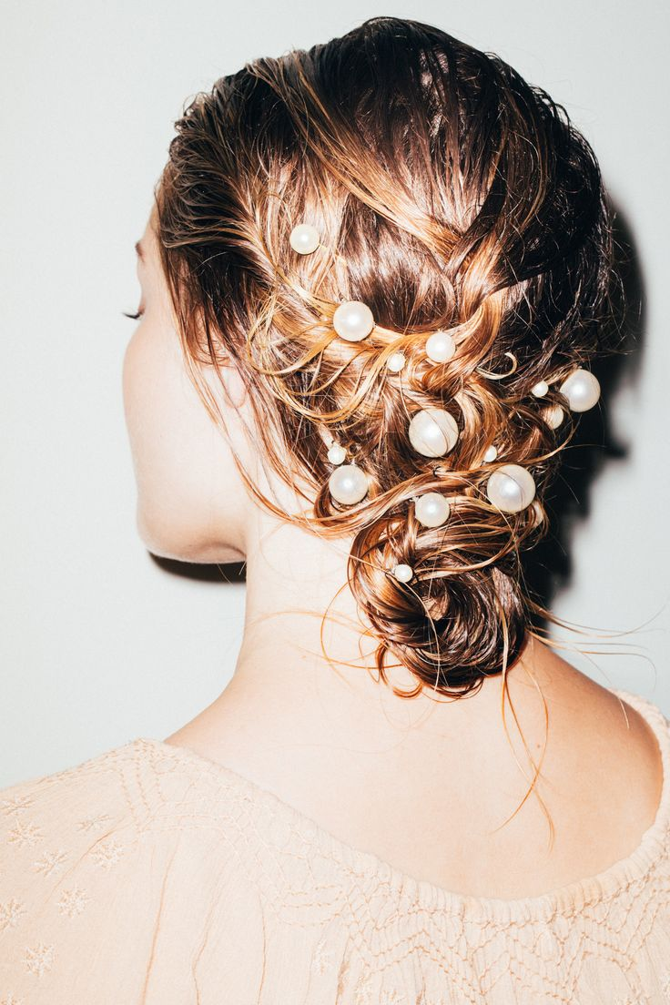 Our Step-by-Step Guide to Styling Hair Accessories: In the summer, we just want to look like we're a pretty French lady casually twirling around in the fields of Provence. And the fastest way to bring mid-summer romance in a simple, breezy nightgown twirling dress is with a few twists of hair and dreamy hair accessories. -- Big pearl pins | coveteur.com