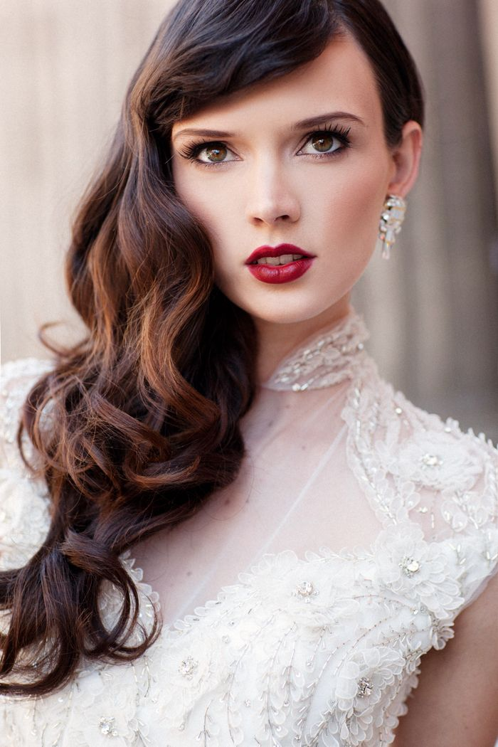 A dramatic red lip is a big part of retro fashion! We love this paired with an @Ines Di Santo gown.