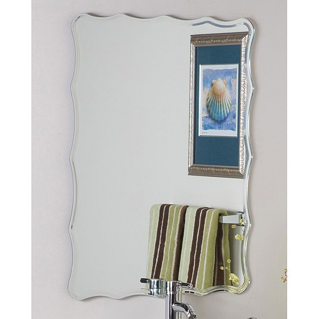 Let this up-to-the-minute contemporary frameless mirror be a reflection of your exquisite taste. This bathroom mirror has a wavy-edged design and silver trim for a brilliant look that sets a modern, contemporary tone in the bathroom.