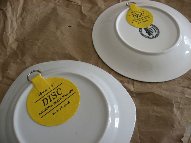 Disc Hangers for hanging plates on wall. Make sure you get the right size for the weight. (Available at Jo-Ann Fabrics)