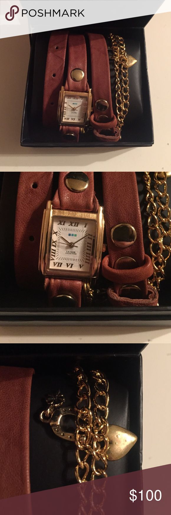 La Mer wrap watch Brown and gold leather wrap watch with charms. Negotiable within reason :) Needs a new battery La Mer Collections Jewelry Bracelets