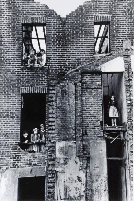 Photo by Roger Mayne, 1954 of children in a bombed-out building in Bermondsey, London.
