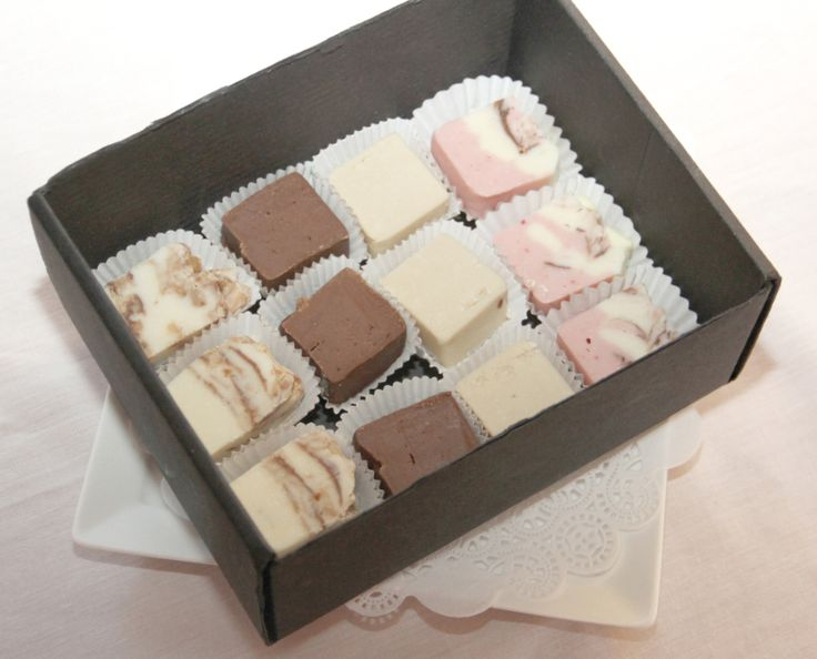 A box of bite sized fudge treats.