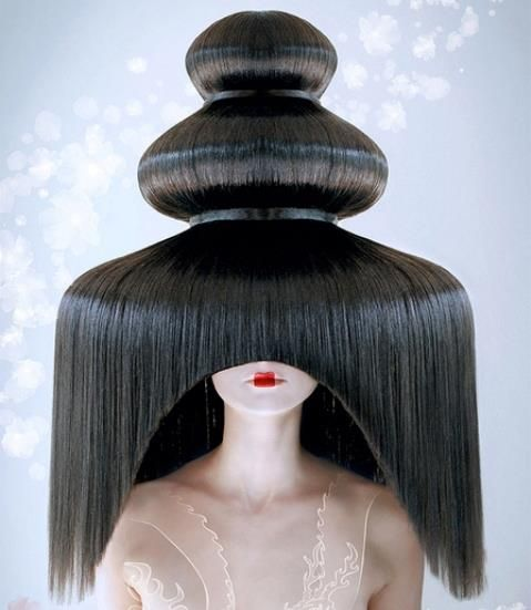 It's either a chocolate fountain or a live model from a Dr. Seuss book ;) Crazy. Olivier Chomienne hairstylist