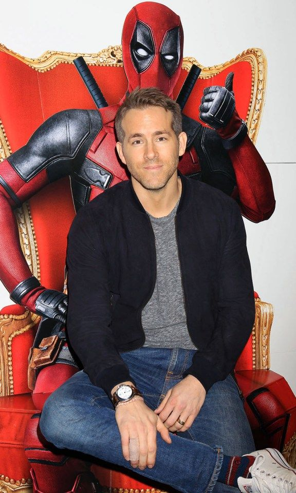 "Ryan Reynolds cozies up to ""Deadpool"" ahead of an advanced screening of the comic book adaptation on Monday in New York."