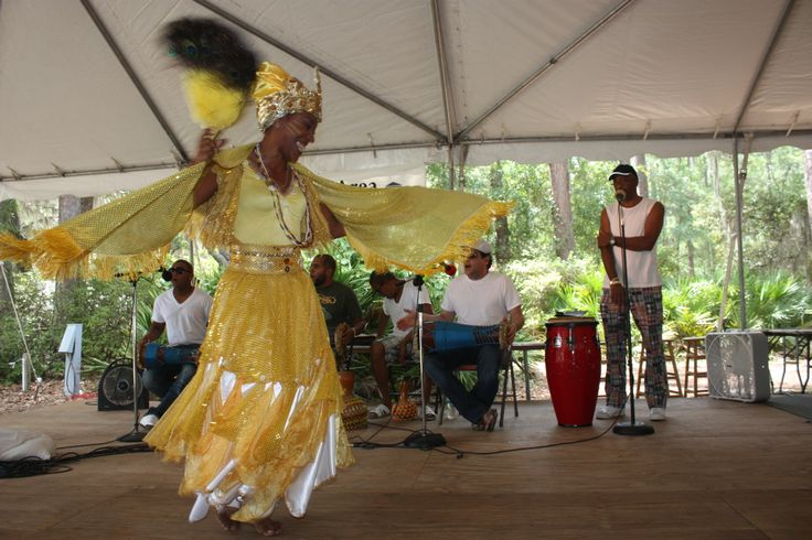 Dancer in yellow costume performs traditional dance