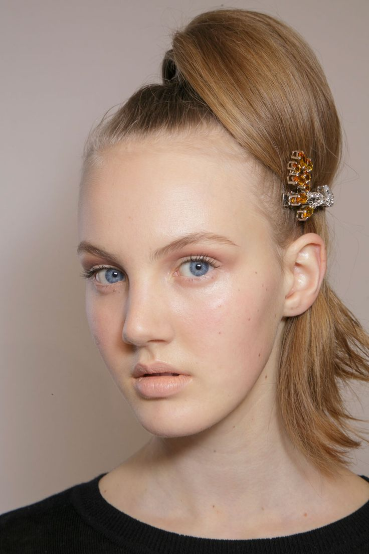 High ponytails were given a twist at Prada with some stunning crystal clips. The makeup was minimal, with warm contours and nude lips.   - Cosmopolitan.co.uk