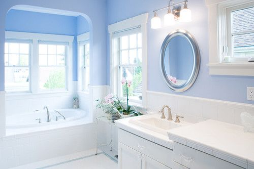 I like the colors here: crisp white accents, silver hardware, and a bright blue to bring brightness into a space without windows. Similar color to Valspar's July Sky.