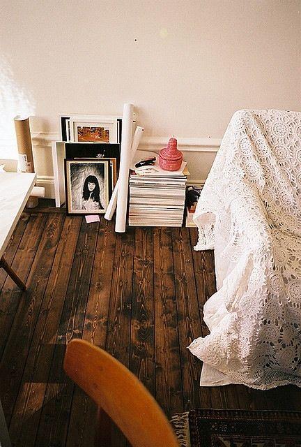Light furniture and fabrics against dark wood