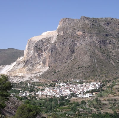 Cobdar pueblo, settled at the foot of the enormous rock for which its white marble is famous.