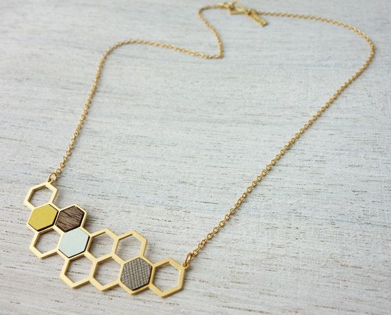 Delicate bib necklace inspired by Scandinavian design, comprised of numerous geometric polygon shapes. Made of high quality 24K matte gold or silver