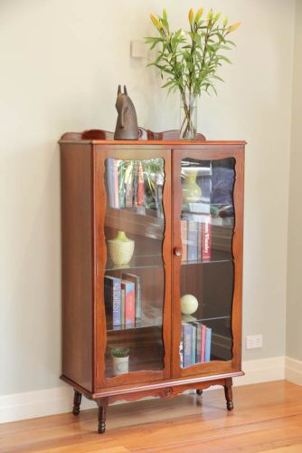 T.H. Brown & Sons glass display cabinet bookcase c1960s. Solid Oak construction, beveled top and turned, splayed legs