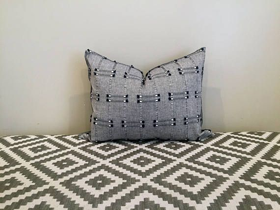 Dress up your home in an instant with this blue fringe pillow cover. This classic pillow cover features a fun line design that's made more fun with the small tassel details, while keeping things subtle enough to pair with any existing styles.  This cover is made from 100% Cotton.