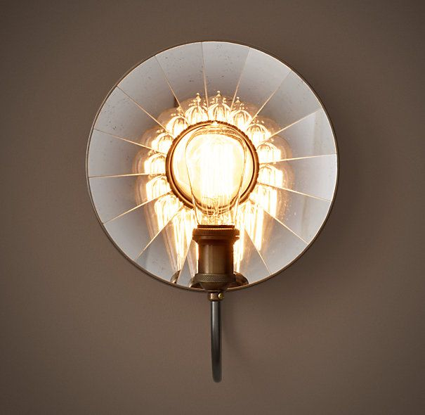 1910 reflector filament antiqued sconcein the millennia old tradition of amplifying light via a reflective surface our sconce showcases the warmth of a