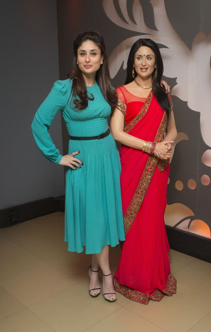 Kareena Kapoor dressed in a teal Michael Kors dress with black Saint Laurent sandals at Madame Tussauds. #Bollywood #Fashion #Style #Beauty