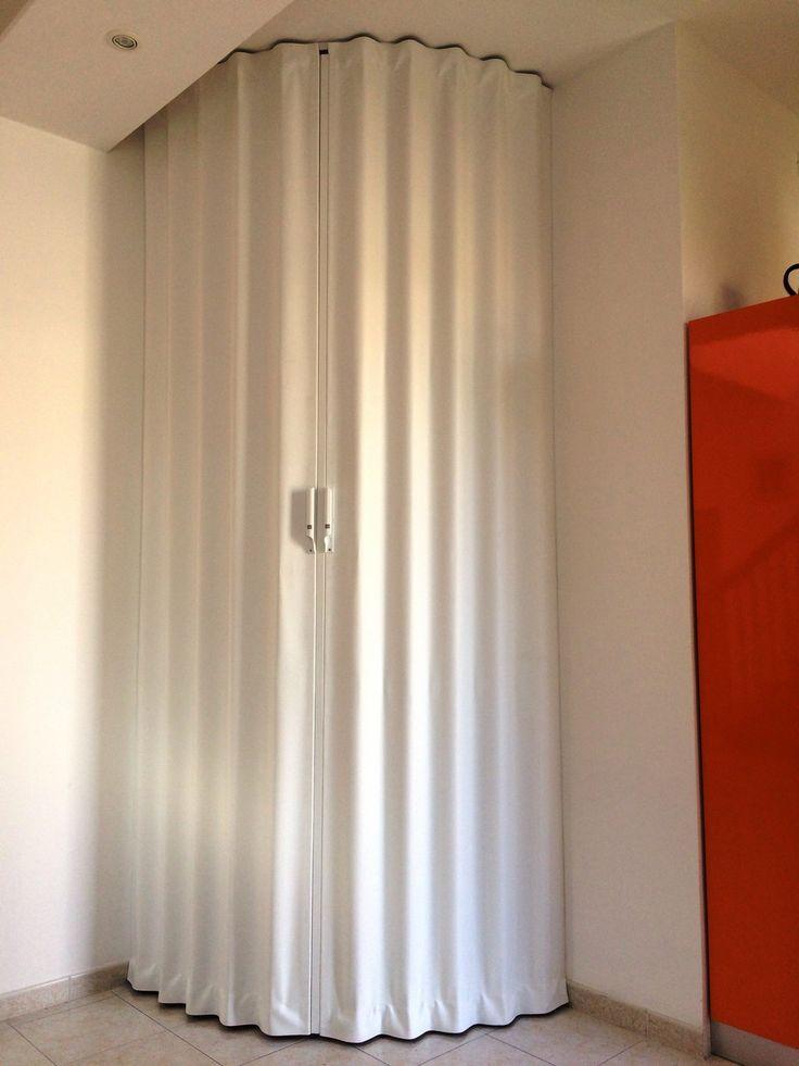 Porta a soffietto curva arancione bianco - abitazione privata - FanoflexFanoflex