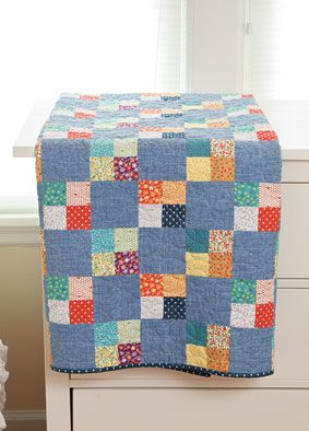 Simple piecing will leave you with a delightful quilt fit for a picnic in a meadow or as a charming gift for a loved one. The City Charm Quilt Kit from Connecting Threads