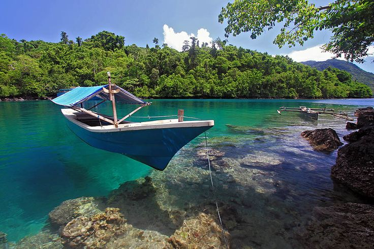 The Cristal Clear water in Sulamahada Beach on the North of Ternate city. Notice how the sampan seems like hovering over the water... #iloveindonesia