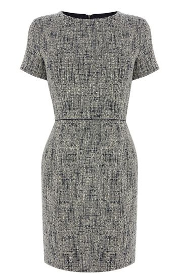 Tweed never goes out of fashion and this chic mini skirt is one of our favourite pieces right now. The shift dress features a textured boucle effect across the fabric and has a nipped in waist for a super flattering fit. The piece is finished with a contrasting piped trim and exposed zip fastening on the reverse.