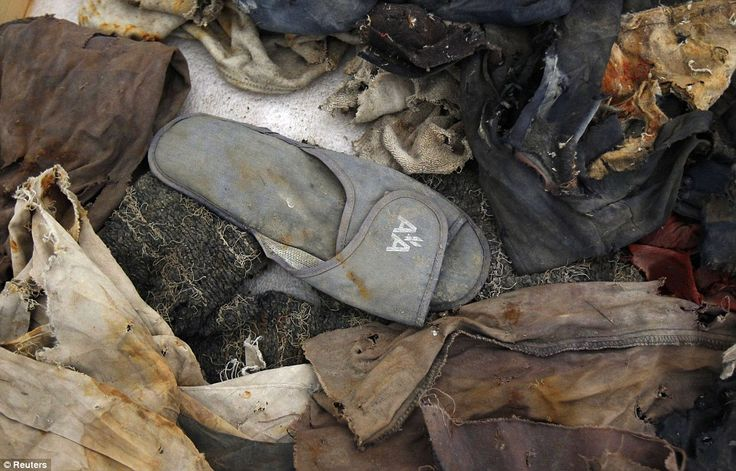 Tattered clothes recovered from the World Trade Center site in New York after 9/11, including an American Airlines flight slipper.