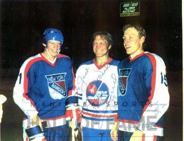 Anders Hedberg and Ulf Nilsson with old WHA teammate Bobby Hull after joining the Rangers.
