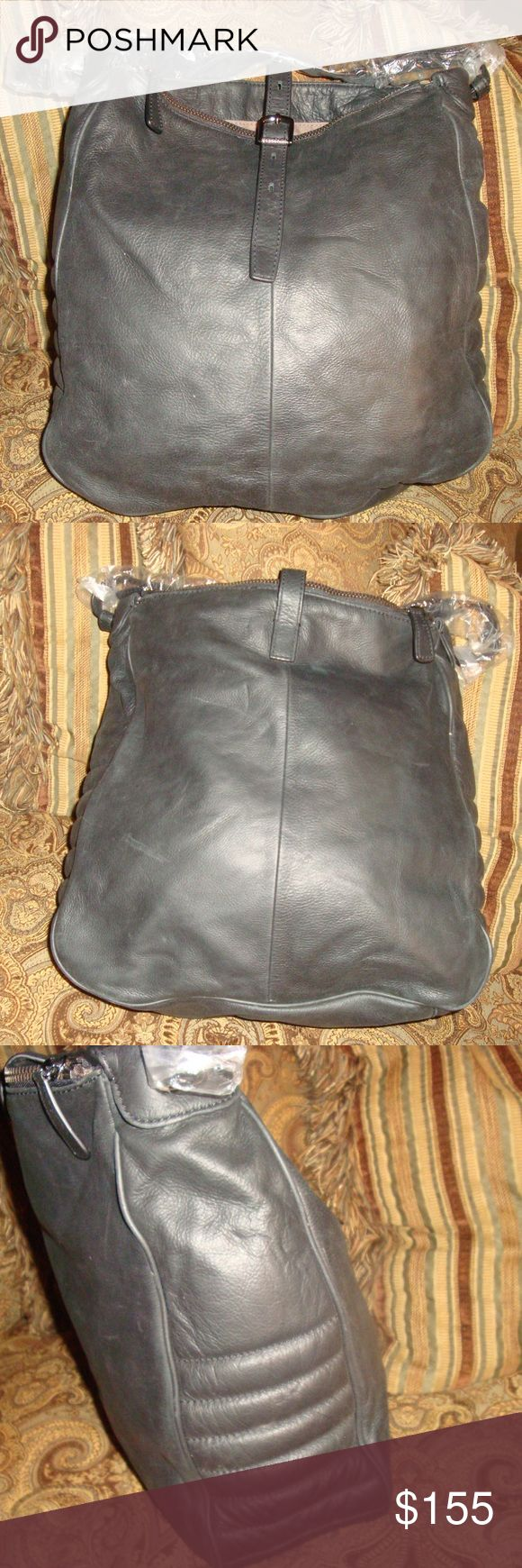 "NWT Black Leather J CREW Hobo Shoulder Bag NWT Black Leather J CREW Hobo Shoulder Tote measures 12 1/2"" X 5"" X 13 1/2"" and has a single 12"" strap drop. This bag has two outer zip compaertments and a center compartment which has a zip pocket and two slip pockets. This is a great bag which has never been used. J Crew Bags Totes"