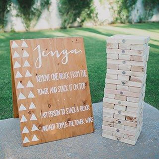 From a life-size Jenga board to corn hole, here are a few games even the most mature adults will love to play at your reception.