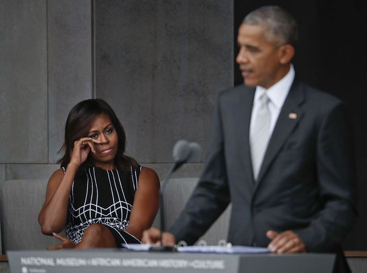 First lady Michelle Obama wipes her eyes as she listens to her husband, President Barack Obama, speak at the dedication ceremony for the Smithsonian Museum of African American History and Culture on the National Mall in Washington, Saturday, Sept. 24, 2016. (AP Photo/Pablo Martinez Monsivais)</p>